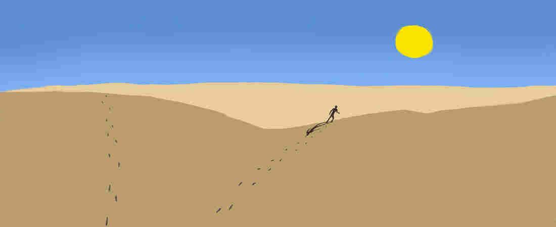 Man on sand dunes.
