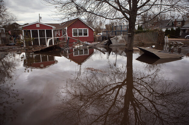 Water continues to flood a neighborhood on Thursday in the Ocean Breeze area of the Staten Island borough of New York City.