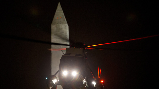 The Marine One helicopter carrying President Obama returns to the White House on Friday after Obama spent the day campaigning in Ohio. Both the president and Mitt Romney were to be on the road all weekend, campaigning in a handful of swing states. (AP)