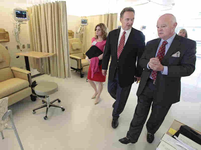 Republican Congressman Dan Lungren (center) tours a cancer center in Sacramento, Calif. Lungren is running for re-election in California's 7th Congressional District.