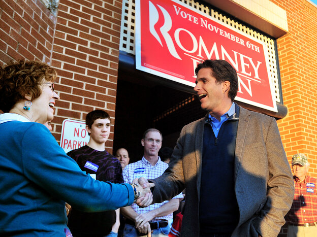 Tagg Romney, the eldest son of presidential candidate Mitt Romney, shakes hands with Barbara Irby at GOP headquarters in Lynchburg, Va., last month.