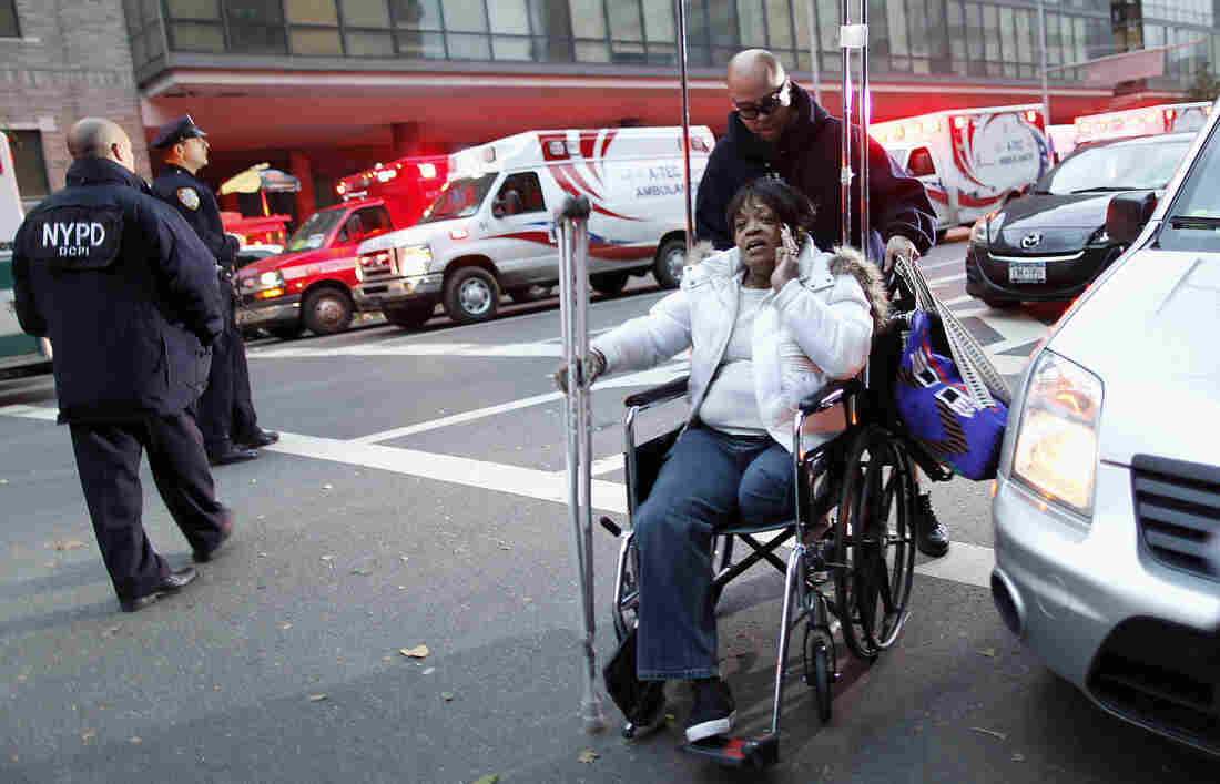 Barbara Fleming is evacuated from Bellevue Hospital by Victor Rivera in the aftermath of Superstorm Sandy in New York on Oct. 31.