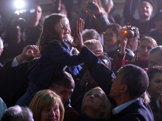 President Obama gives a girl a high five at a campaign rally in Hilliard, Ohio, on Nov. 2. (AFP/Getty Images)
