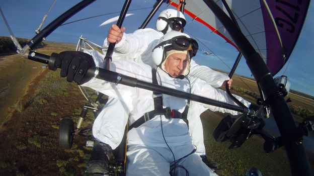 Russian President Vladimir Putin pilots a motorized hang glider while taking part in a project to help endangered cranes on Sept. 5. Shortly after, the president — who has cultivated the image of a man of action — was photographed wincing in apparent pain. (AFP/Getty Images)