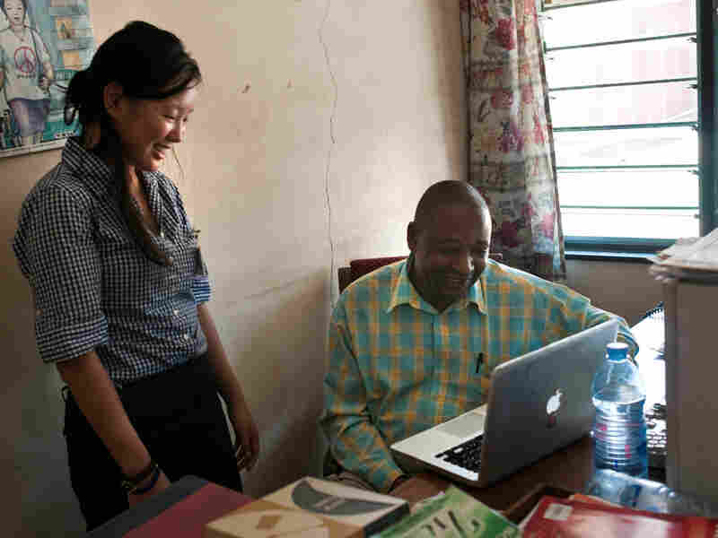 Rebecca Corey, project director for the Tanzania Heritage Project, and archivist Bruno Nanguka are working to save Radio Tanzania's reel-to-reel tapes.