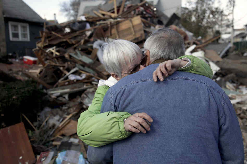 Sheila and Dominic Traina hug in front of their home, which was demolished.