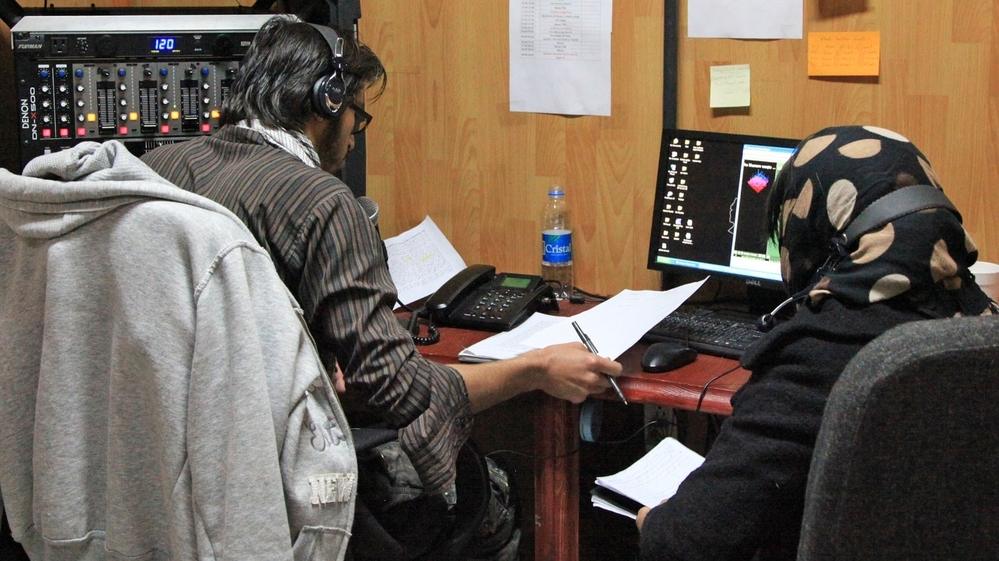 Unidentified Afghan civilians broadcast a radio program from the radio studio at Forward Operating Base Shank in Logar province, south of Kabul. The U.S. military is training Afghans to disseminate anti-insurgent messages via local radio.