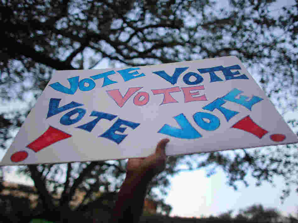 "A sign reading ""Vote"" is held up during a rally for President Obama on Oct. 27 in Miami, Fla."