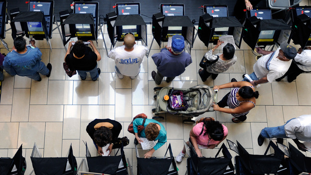 Voters cast their ballots during the first day of early voting at the Meadows Mall on Oct. 20 in Las Vegas, Nev. (Getty Images)