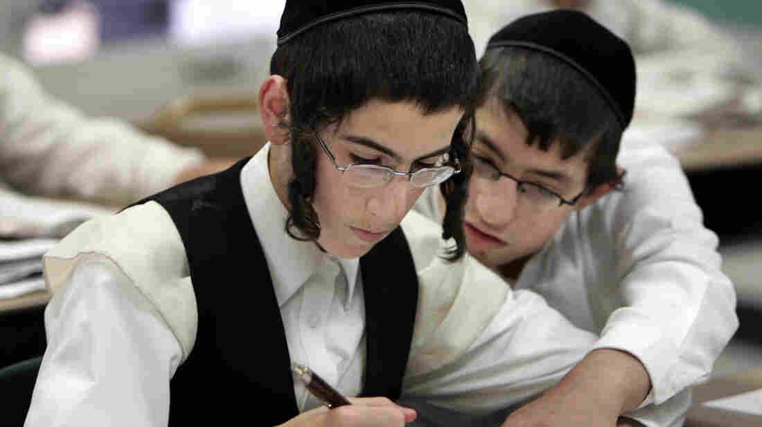 Two boys study together at a Chicago yeshiva in 2009. Public health officials say this type of close physical contact helped fuel a mumps outbreak throughout several orthodox Jewish communities in and around New York City.