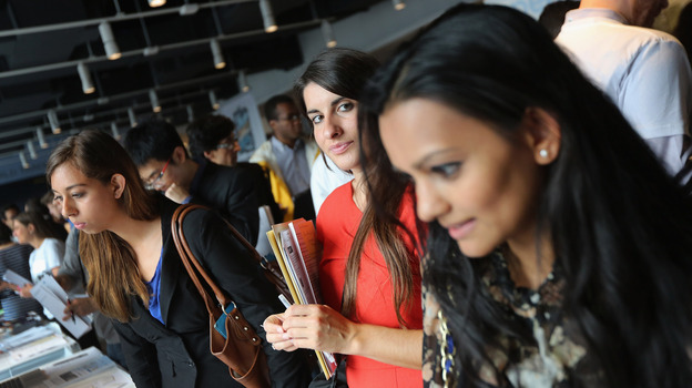 Job applicants meet potential employers at the NYC Startup Job Fair in September. Last month, the private sector created jobs while the public sector resumed laying off workers. (Getty Images)