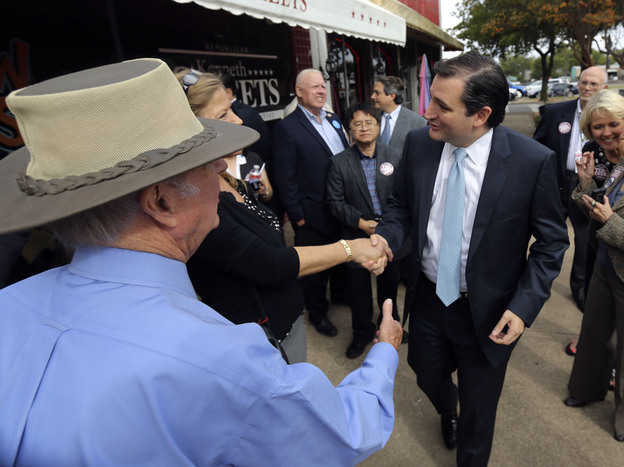 Republican Ted Cruz (center), a candidate for U.S. Senate, greets voters in Mesquite, Texas, last month. Cruz has an 18-point lead over his challenger. (AP)