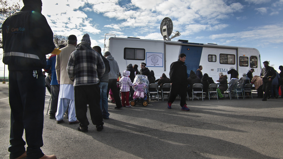 Victims of Superstorm Sandy wait in line to apply for recovery assistance at a FEMA processing center Friday on New York's Coney Island. The agency has been praised for its response to the storm. (AP)