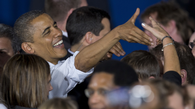 President Obama greets audience members Saturday after speaking at a campaign event at Mentor High School in Mentor, Ohio, before traveling to Milwaukee for another campaign event. (AP)