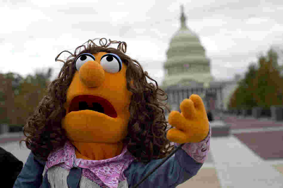 Laura Gentry holds a puppet as she shows her support for public broadcasting near the U.S. Capitol.