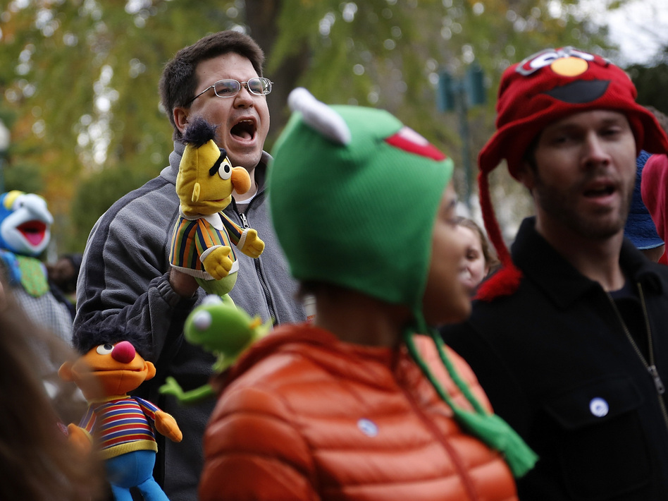 A marcher with a puppet of Bert, the Muppet character from <em>Sesame Street</em>, shouts during The Million Muppet March in Washington, D.C., on Saturday. The bipartisan rally was organized to show support for public broadcasting following Republican presidential candidate Mitt Romney's pledge to cut funding to PBS.