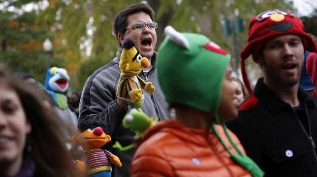 A marcher with a puppet of Bert, the Muppet character from Sesame Street, shouts during The Million Muppet March in Washington, D.C., on Saturday. The bipartisan rally was organized to show support for public broadcasting following Republican presidential candidate Mitt Romney's pledge to cut funding to PBS. (Reuters /Landov)