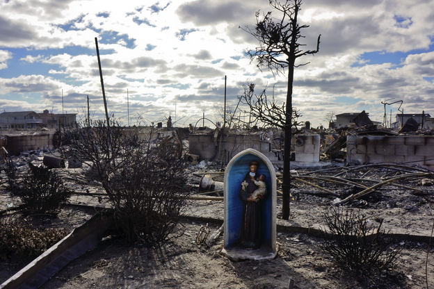 A chapel icon that once adorned the front of a beachfront home is one of the few items to have survived what is now known as the Breezy Point fire in Queens. (NPR)