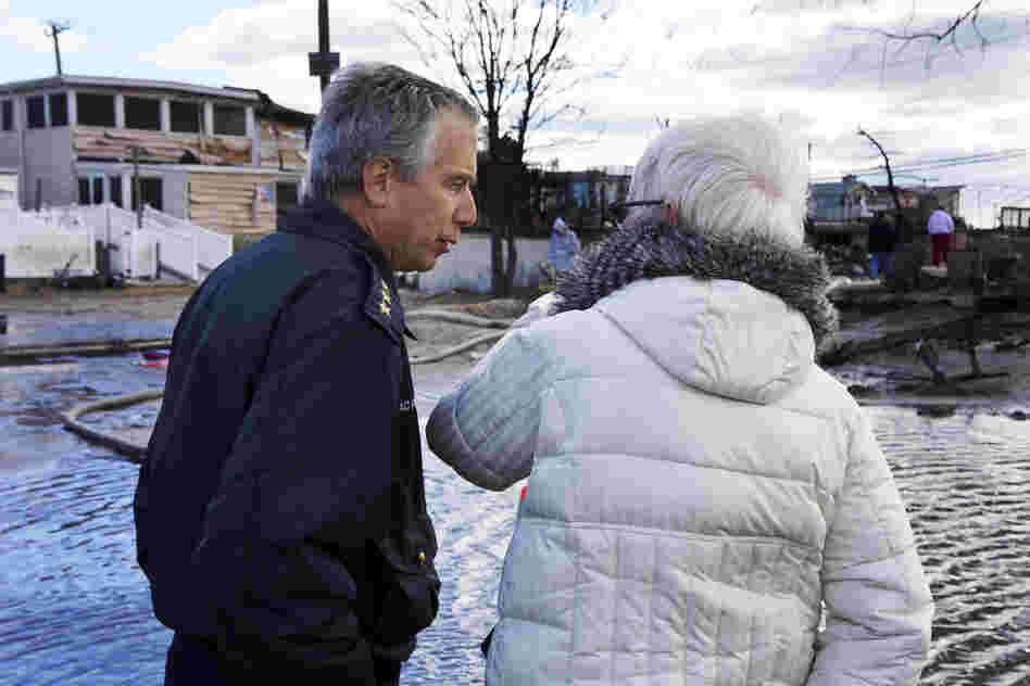 New York Fire Department Chief Joseph Pfeifer consoles a woman who lost her home. 111 homes were lost in this small seaside community, as fires raged in the 50 mile an hour winds if Superstorm Sandy.