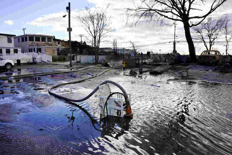 """Fire Fighters are now part of a massive de-watering effort in Breezy Point. """"We're trying to put the water back where it came from,"""" says Chief Pfifer."""