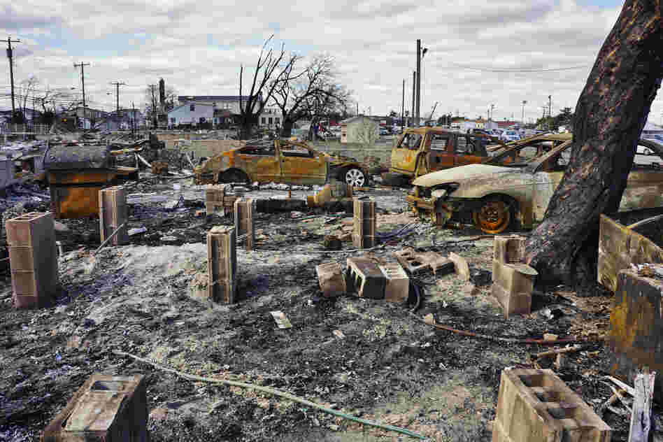 Everyone in the community has been evacuated and no deaths where reported as a result of the Breezy Point fire. Summer cars and barbecues were among the few recognizable signs of life after the fire.