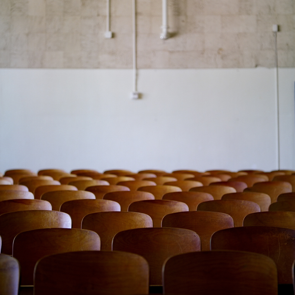 An empty theater at H.S. Thompson Elementary School.