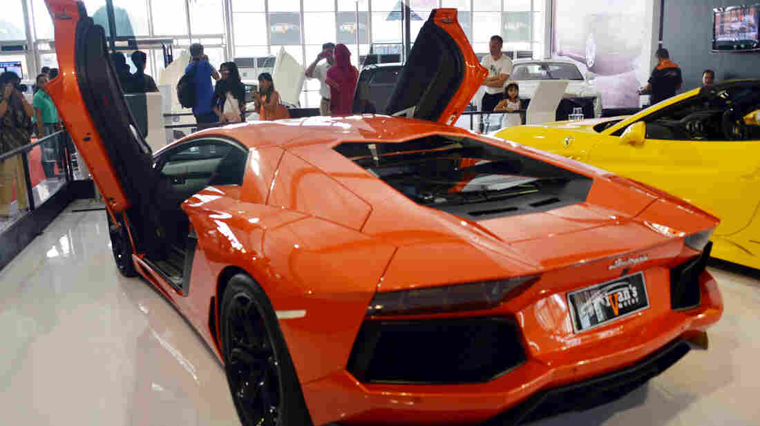 The Italian-built Lamborghini Aventador costs nearly $400,000. The money spent on election 2012 — for TV ads and other things — could theoretically get you more than 15,000 of these V12 cars. But that's a lot more than have been built.