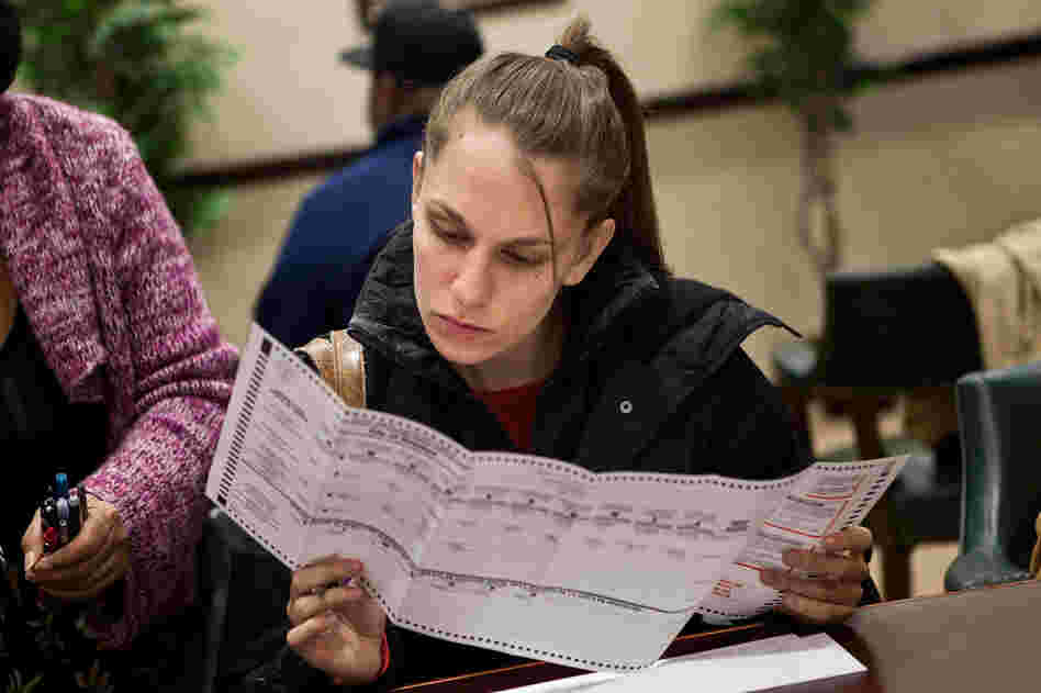A voter fills out a ballot Sunday in Jersey City, New Jersey. Gov. Chris Christie ordered early-voting stations to stay open through the weekend.