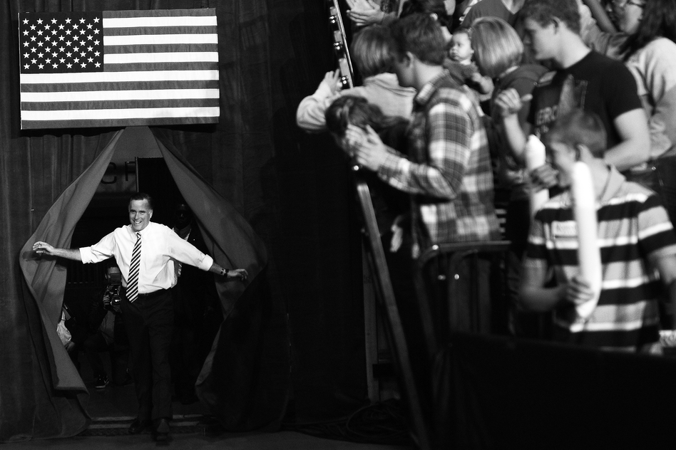 Republican Presidential candidate Mitt Romney arrives for a rally in Des Moines, Iowa, on Sunday. (AFP/Getty Images)