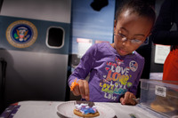 Olyvia Berry, 7, decorates a sugar cookie at Madame Tussauds Wax Museum. Encouraging kids to vote through age appropriate activities is a fun way to share Election Day.