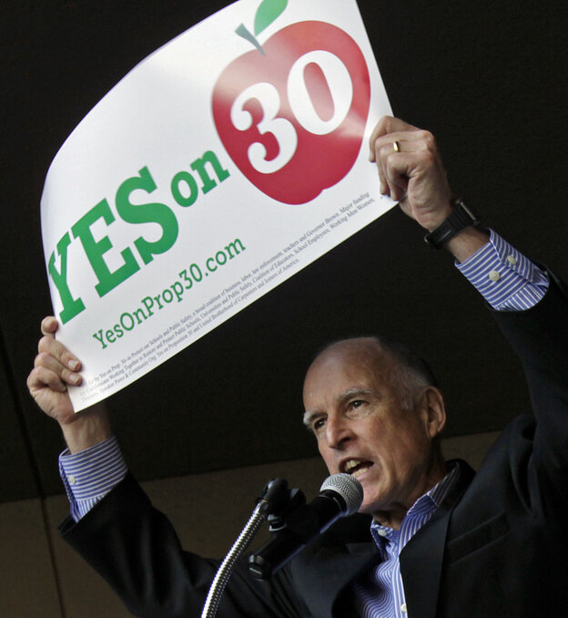 California Gov. Jerry Brown appears at a rally in downtown Los Angeles on Saturday.