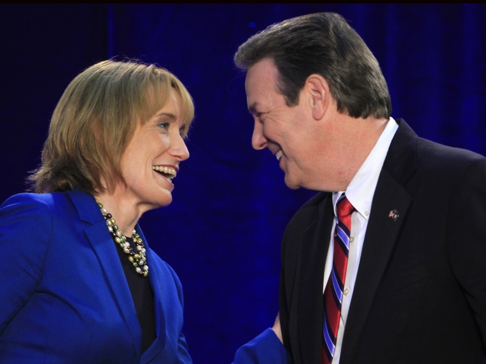 New Hampshire gubernatorial candidates Democrat Maggie Hassan and Republican Ovide Lamontagne talk before their Oct. 4 debate in Henniker, N.H.