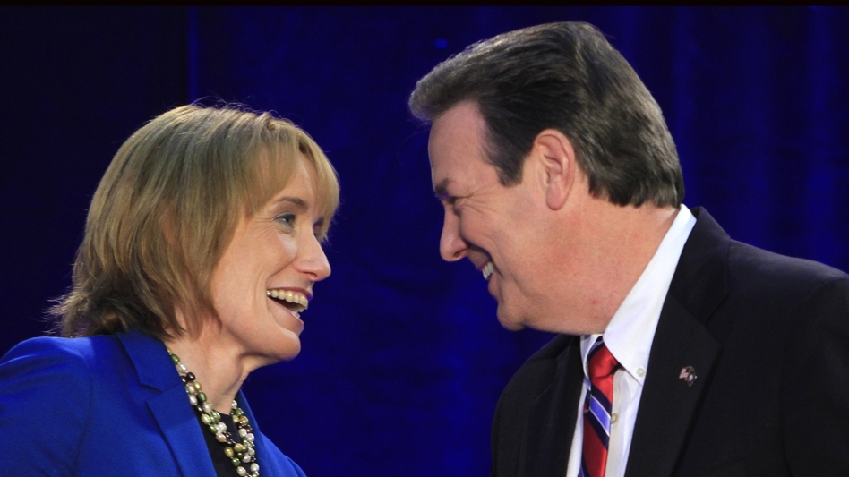 New Hampshire gubernatorial candidates Democrat Maggie Hassan and Republican Ovide Lamontagne talk before their Oct. 4 debate in Henniker, N.H. (AP)