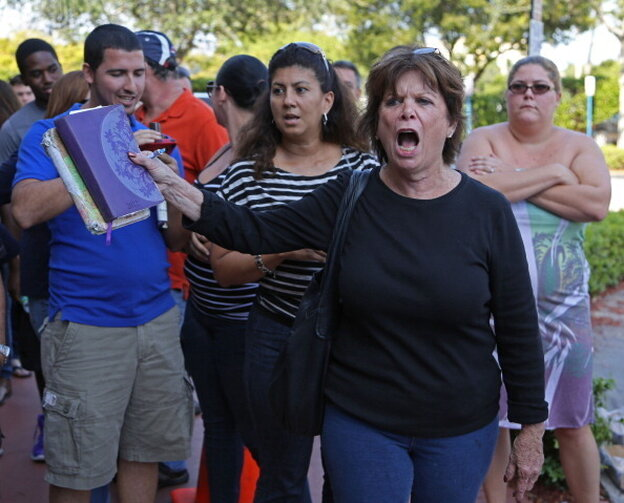 Kendall, Florida, resident, Diane, right, demands access to early voting. Hundreds stood in line at the Miami-Dade Elections Department to vote early.