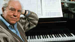 Composer Elliott Carter at the piano in 1989.