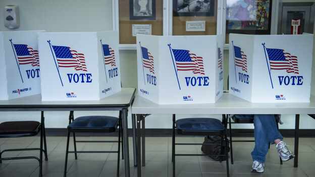 A citizen votes on a paper ballot during the final day of early voting Monday in Lancaster, Ohio. (AFP/Getty Images)