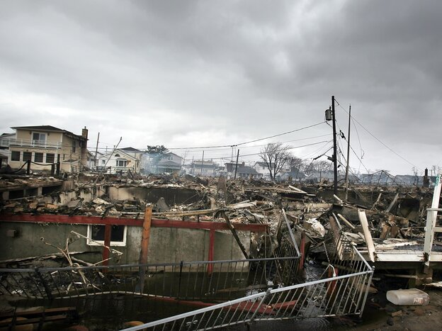 Homes sit smoldering after Hurricane Sandy on Oct. 30, 2012 in the Breezy Point Neighborhood of the Queens borough of New York City.