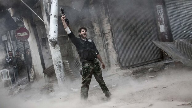 A rebel fighter raises his weapon after firing a missile Sunday toward Syrian government troops in the northern city of Aleppo. Syria's largest city has been the scene of heavy fighting for the past three months. Both sides control part of the city, and the fight has been a stalemate