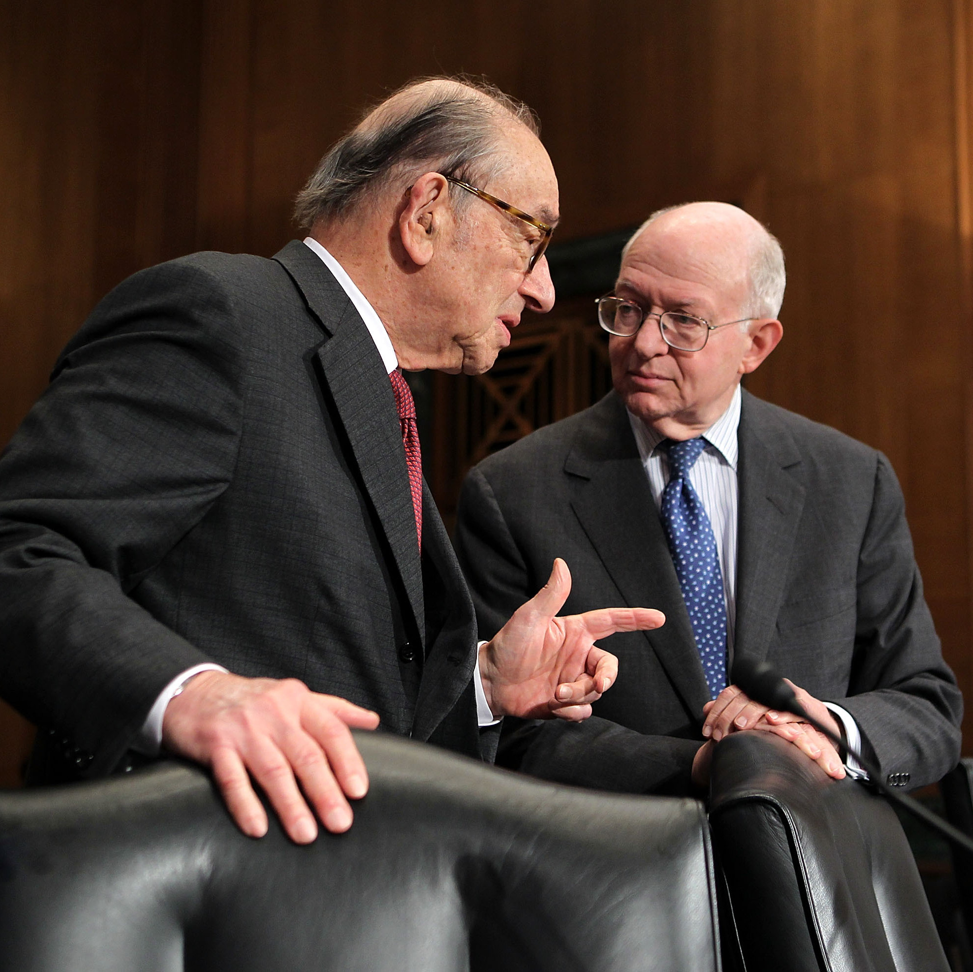 Stanford economics professor John Taylor (right) could be Romney's pick to replace Fed Chairman Ben Bernanke. Here, he speaks with former Federal Reserve Chairman Alan Greenspan.