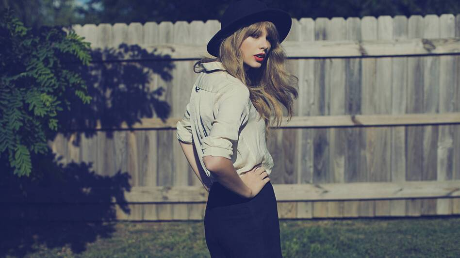 Taylor Swift's <em></em><em>Red</em> challenges her diehard fans while inviting naysayers to give her music another try.