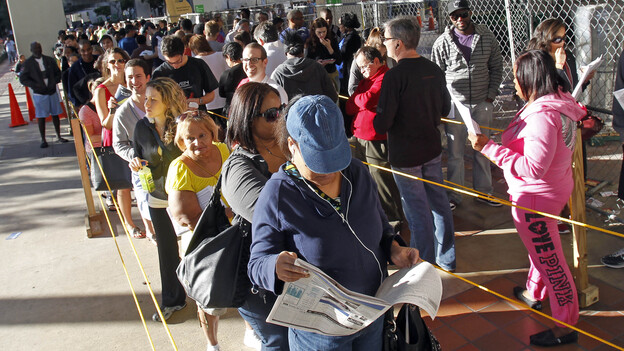 Floridians stand in line during the last day of early voting in Miami on Saturday. A judge extended early-voting hours in one Florida county Sunday after Democrats sued to allow more time. (AP)