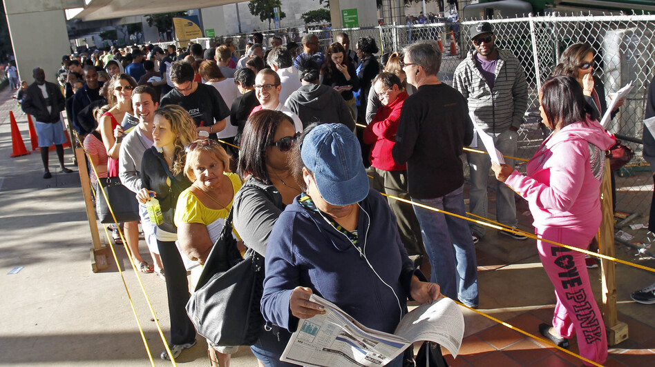 South Floridians stood in long lines Sunday during the last day of early voting in Miami. (AP)