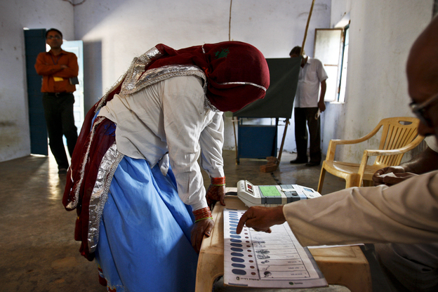 A Hindu woman learns how to use an electronic voting machine at a rural polling booth in Kot, Haryana, India, 2009.