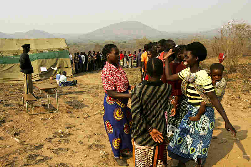 Voters in Zambia stand in line at a polling station in the village of Palabana during the country's general elections, 2006.