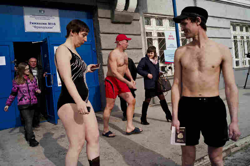 In Russia, winter swimming enthusiasts leave a polling station after casting their presidential votes near the icy waters of Novosibirsk, 2012.
