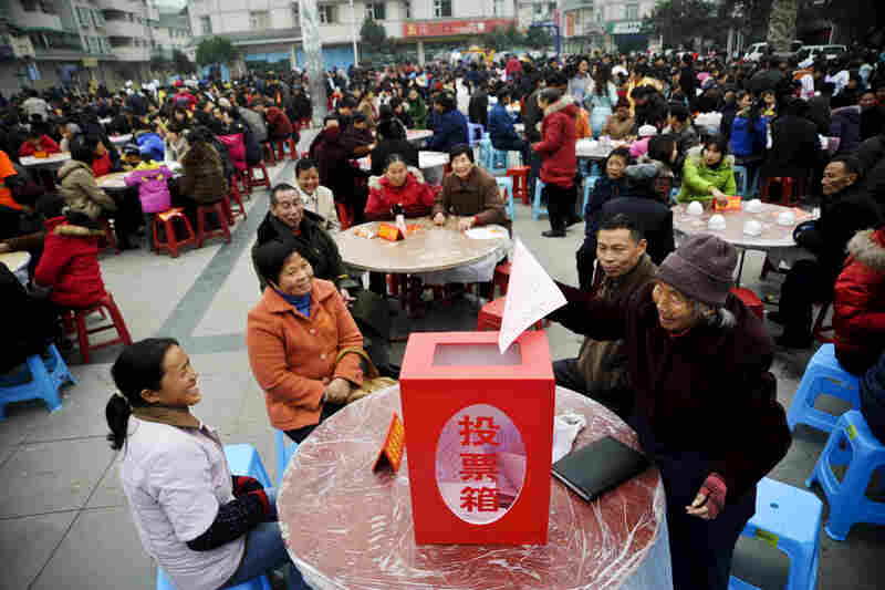 Villagers submit forms during a poll in Sichuan Province, China, 2009.