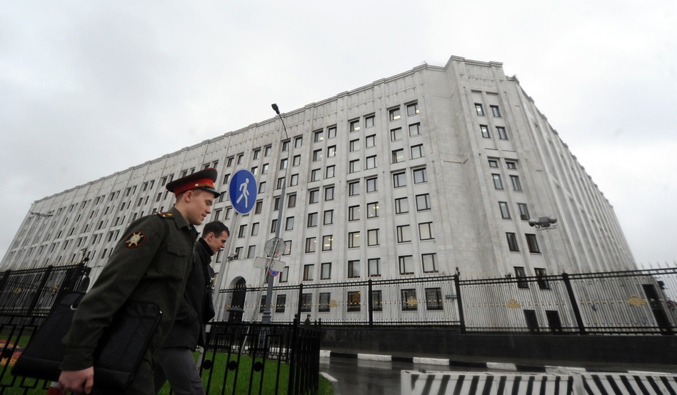 A Russian Army officer walks past Defence Ministry offices in Moscow, on Tuesday. Putin fired defence minister Anatoly Serdyukov over a corruption scandal, the most dramatic change to the government since he returned to the Kremlin for a third term.