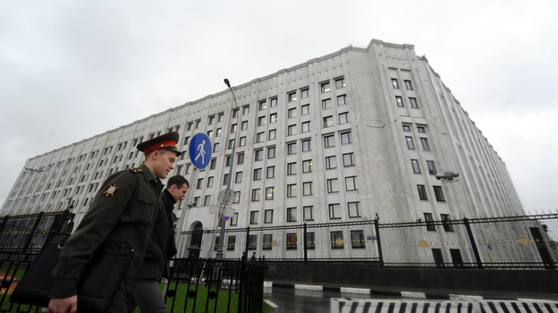 A Russian Army officer walks past Defence Ministry offices in Moscow, on Tuesday. Putin fired defence minister Anatoly Serdyukov over a corruption scandal, the most dramatic change to the government since he returned to the Kremlin for a third term. (AFP/Getty Images)