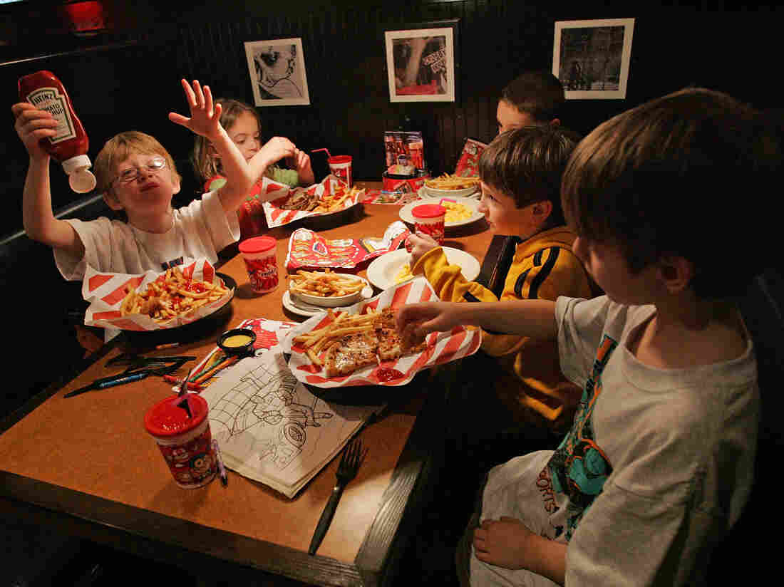 When they eat out at a restaurant, kids consume more calories than they do at home. Here, members of the Long Island Gulls hockey team enjoy a lunch at TGI Friday's back in 2007 in Marlborough, Mass.