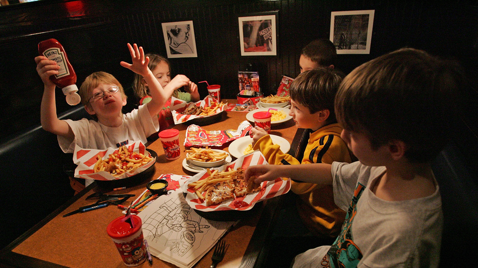 When they eat out at a restaurant, kids consume more calories than they do at home. Here, members of the Long Island Gulls hockey team enjoy a lunch at TGI Friday's back in 2007 in Marlborough, Mass. (Getty Images)